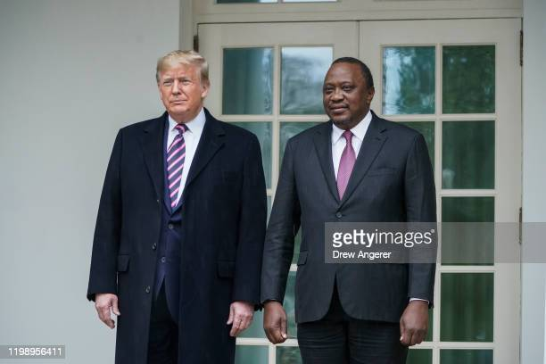 US President Donald Trump walks with Kenyan President Uhuru Kenyatta on the White House colonnade as they make their way to the Oval Office on...