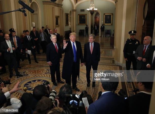 S President Donald Trump walks with Senate Majority Leader Mitch McConnell and Sen Roy Blunt after arriving at a Senate Republican weekly policy...