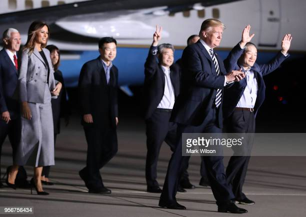 S President Donald Trump walks with the three Americans just released from North Korea Kim Dong Chul Kim Haksong and Tony Kim at Joint Base Andrews...