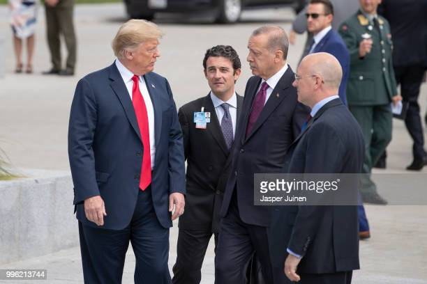 President Donald Trump walks with Turkish President Recep Tayyip Erdogan at the 2018 NATO Summit at NATO headquarters on July 11 2018 in Brussels...
