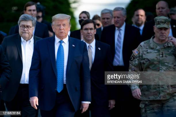 US President Donald Trump walks with US Attorney General William Barr US Secretary of Defense Mark T Esper Chairman of the Joint Chiefs of Staff Mark...