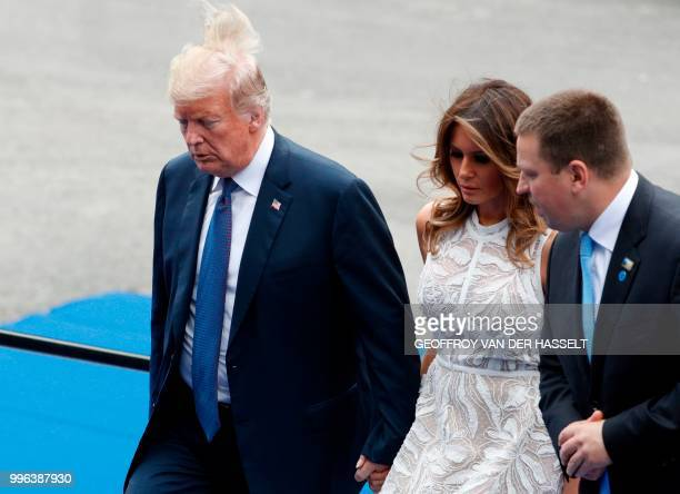US President Donald Trump walks with US First Lady Melania Trump and Estonia's Prime Minister Juri Ratas as they arrive for a working dinner at The...