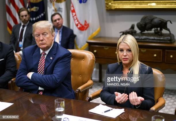 US President Donald Trump watches as Florida Attorney General Pam Bondi speaks during a meeting with state and local officials on school safety in...