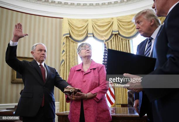 S President Donald Trump watches as Jeff Sessions is sworn in as the new US Attorney General by US Vice President Mike Pence in the Oval Office of...