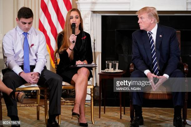 President Donald Trump watches as Julia Cordover Parkland student body president speaks during a listening session on gun violence in the State...
