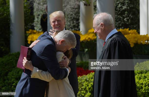 US President Donald Trump watches as Justice after Anthony Kennedy administered the oath of office to Neil Gorsuch as an associate justice of the US...