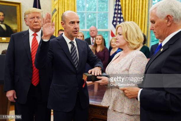 S President Donald Trump watches as Labor Secretary Eugene Scalia is ceremonially sworn in by Vice President Mike Pence as his wife Patricia Scalia...