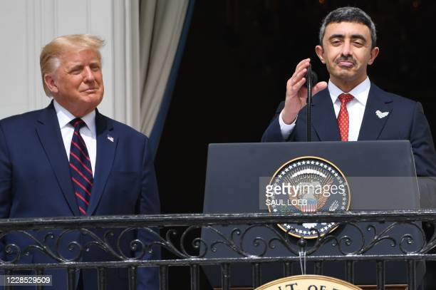 US President Donald Trump watches as UAE Foreign Minister Abdullah bin Zayed AlNahyan speaks from the Truman Balcony at the White House during the...