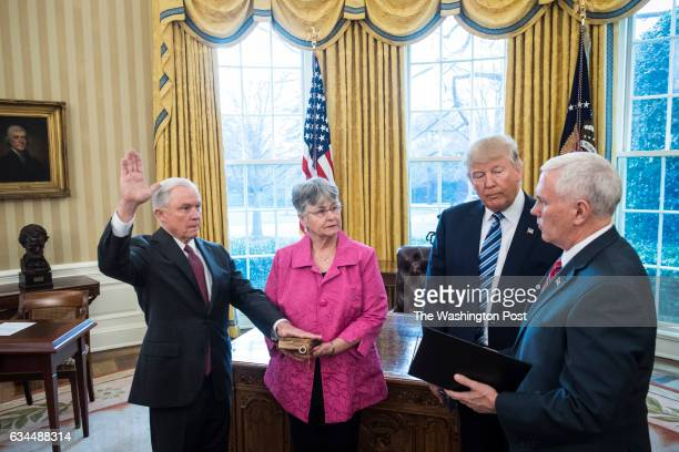 President Donald Trump watches as Vice President Mike Pence administers the oath of office to Attorney General Jeff Sessions accompanied by his wife...
