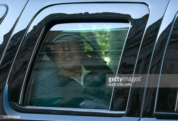 President Donald Trump watches from the motorcade as he returns to the White House in Washington, DC, after playing golf on November 7, 2020. -...