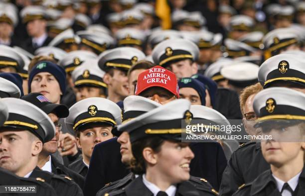 US President Donald Trump watches the game with members of the Navy during the ArmyNavy football game in Philadelphia Pennsylvania on December 14 2019