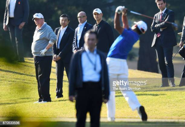 S President Donald Trump watches the shot of Hideki Matsuyama during their golf at Kasumigaseki Country Club on November 5 2017 in Kawagoe Saitama...