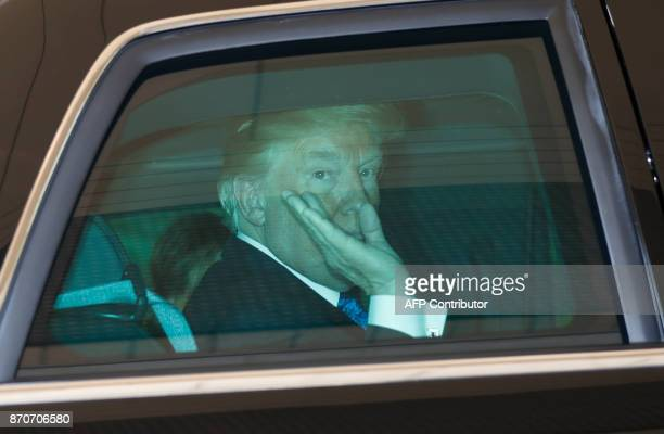 US President Donald Trump waves after a meeting with Japan's Emperor Akihito and Empress Michiko at the Imperial Palace in Tokyo on November 6 2017...