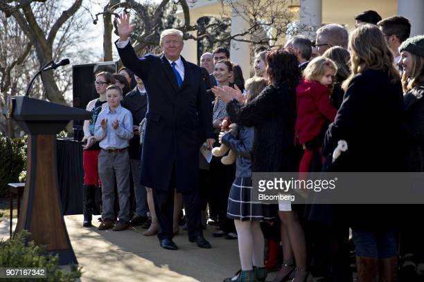 US President Donald Trump waves after addressing March for Life participants and prolife leaders in the Rose Garden of the White House in Washington...
