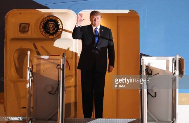 President Donald Trump waves after arriving at Noi Bai airport in Hanoi on February 26 ahead of the second USNorth Korea summit North Korean leader...