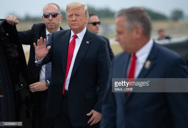 US President Donald Trump waves after arriving on Air Force One at St Louis Lambert International Airport in St Louis Missouri July 26 as he travels...