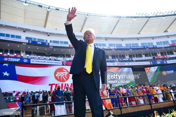 US President Donald Trump waves after attending 'Namaste Trump' rally at Sardar Patel Stadium in Motera on the outskirts of Ahmedabad on February 24...