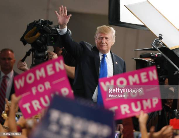 S President Donald Trump waves after being interviewed by Fox News Channel and radio talk show host Sean Hannity before a campaign rally at the Las...