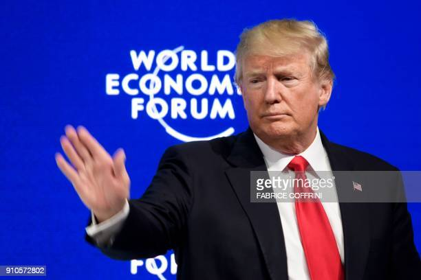 US President Donald Trump waves after delivering his speech during the World Economic Forum annual meeting on January 26 2018 in Davos eastern...