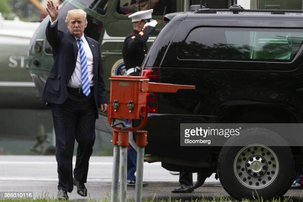 US President Donald Trump waves after exiting Marine One to visit First Lady Melania Trump at Walter Reed National Military Medical Center in...
