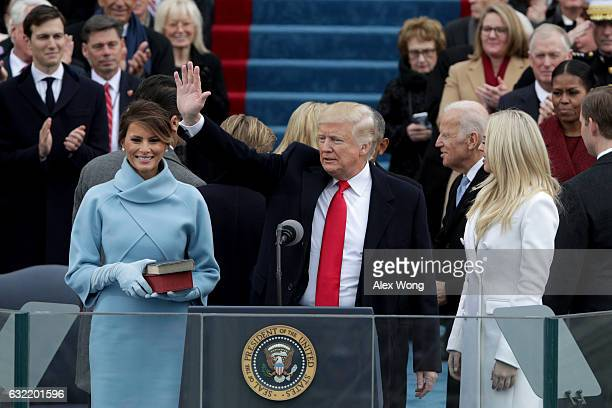 President Donald Trump waves after he is sworn into office on the West Front of the US Capitol on January 20 2017 in Washington DC In today's...