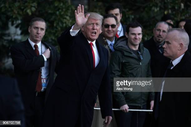 S President Donald Trump waves after he returned to the White House January 17 2018 in Washington DC President Trump returned from a trip to visit HK...