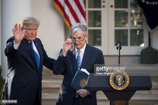 US President Donald Trump waves after introducing his nominee for the chairman of the Federal Reserve Jerome Powell during a press event in the Rose...