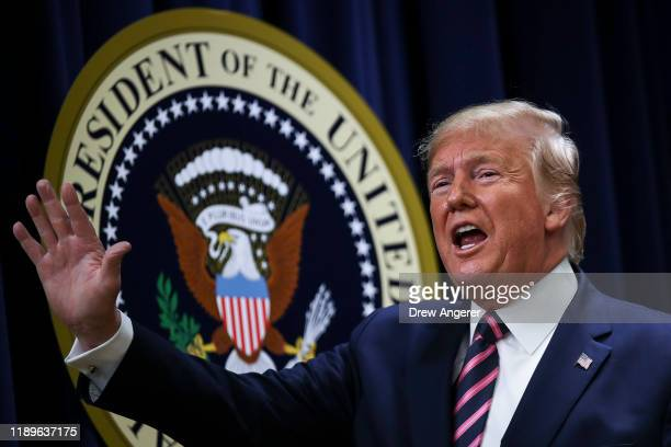 S President Donald Trump waves after speaking at a White House Mental Health Summit in the South Court Auditorium of the Eisenhower Executive Office...