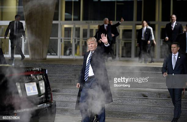 US President Donald Trump waves after speaking at the CIA Headquarters in Langley Virginia US on Saturday Jan 21 2017 Trump assured employees at the...