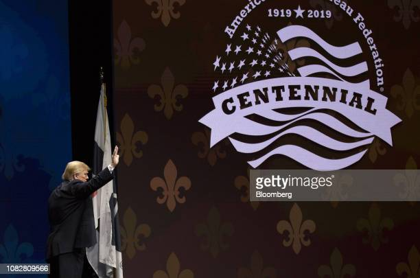 US President Donald Trump waves after speaking during the 100th American Farm Bureau Federation Convention in New Orleans Louisiana US on Monday Jan...