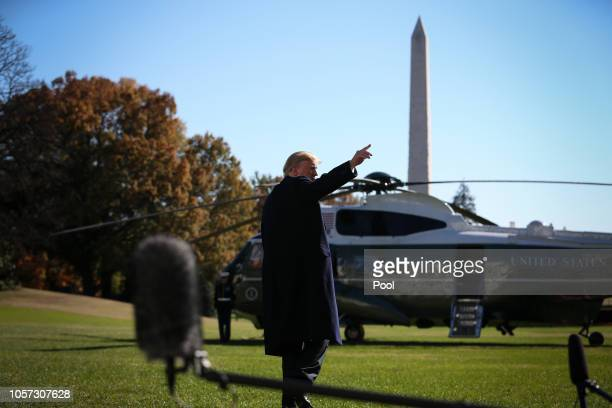 US President Donald Trump waves after talking to reporters before boarding Marine One on the South Lawn of the White House on November 4 2018 in...