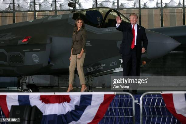 S President Donald Trump waves as first lady Melania Trump looks on after he spoke to Air Force personnel during an event September 15 2017 at Joint...