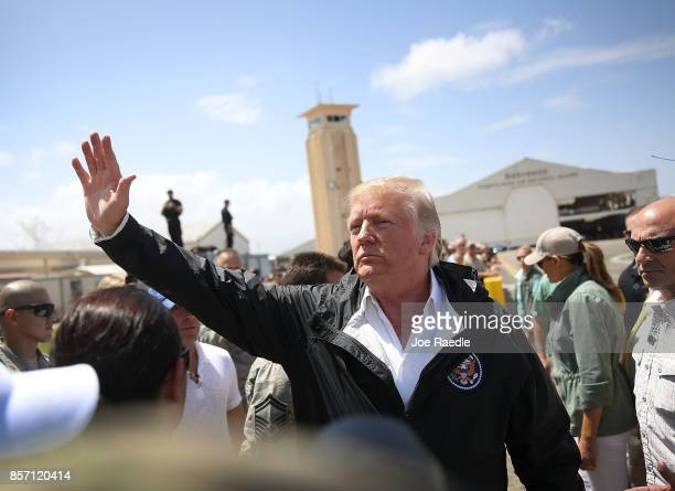 President Donald Trump waves as he arrives at the Muniz Air National Guard Base for a visit after Hurricane Maria hit the island on October 3 2017 in...