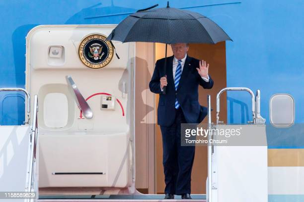 President Donald Trump waves as he arrives at the Osaka International Airport for the G-20 Summit on June 27, 2019 in Osaka, Japan. World leaders...