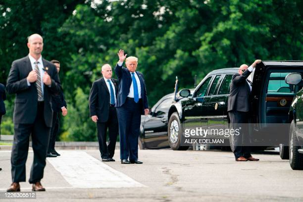 US President Donald Trump waves as he arrives at Walter Reed Military Medical Center on July 11 2020 in Bethesda Maryland
