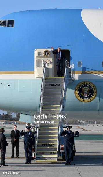 S President Donald Trump waves as he arrives on Air Force One at LAX Airport on February 18 2020 in Los Angeles California
