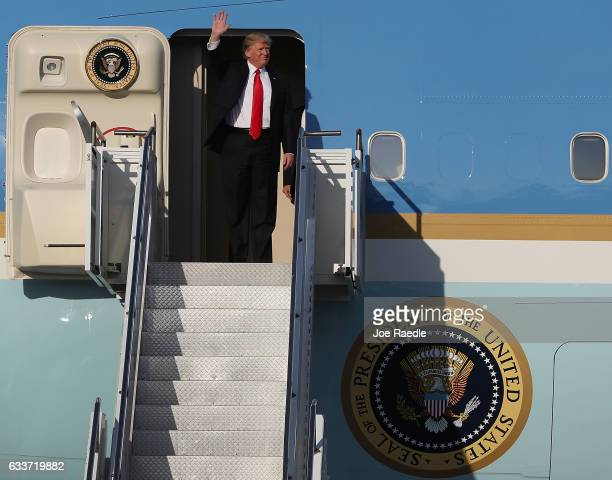 President Donald Trump waves as he arrives on Air Force One at the Palm Beach International Airport for a visit to his MaraLago Resort for the...