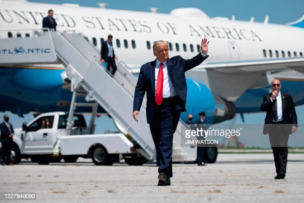 US President Donald Trump waves as he arrives to deliver remarks on economic prosperity at Burke Lakefront Airport in Cleveland Ohio on August 6 2020