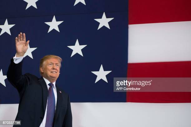 President Donald Trump waves as he arrives to speak to US military personnel at Yokota Air Base at Fussa in Tokyo on November 5 2017 Trump touched...