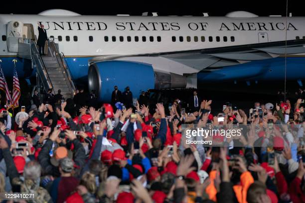 President Donald Trump waves as he boards Air Force One after speaking at a campaign rally in Rome, Georgia, U.S., on Sunday, Nov. 1, 2020. After...