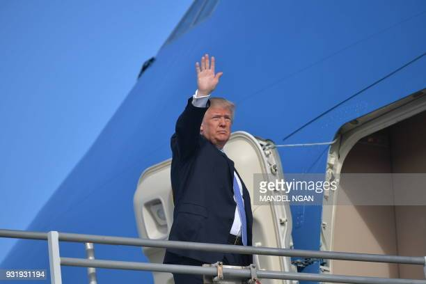 US President Donald Trump waves as he boards Air Force One before departing from Los Angeles International Airport in Los Angeles on March 14 2018...
