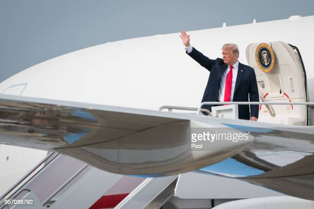 President Donald Trump waves as he boards Air Force One on May 10 2018 at the Joint Base Andrews Maryland Trump is scheduled to fly into South Bend...