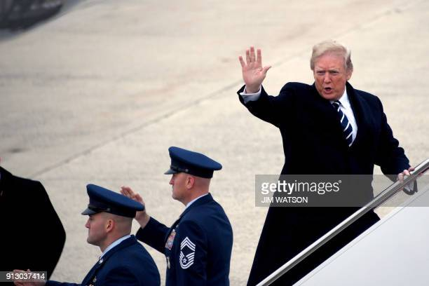 US President Donald Trump waves as he boards the smaller Air Force One before departing Joint Base Andrews on February 1 2018 in Maryland Trump is...