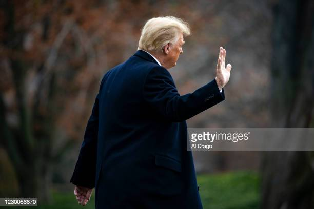 President Donald Trump waves as he departs on the South Lawn of the White House, on December 12, 2020 in Washington, DC. Trump is traveling to the...