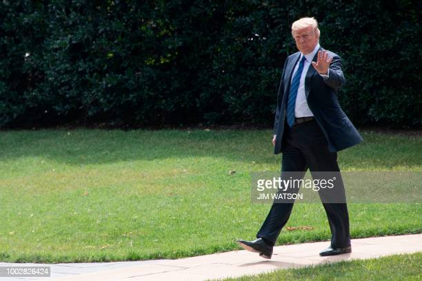 US President Donald Trump waves as he departs the White House in Washington DC on July 20 2018 Trump will be spending the weekend at the Trump...
