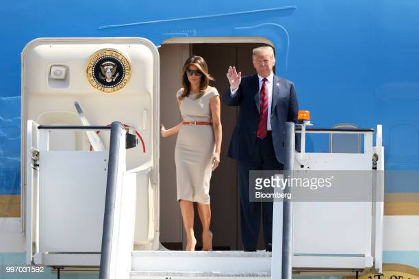 US President Donald Trump waves as he disembarks from Air Force One with US First Lady Melania Trump at London Stansted Airport in Stansted UK on...