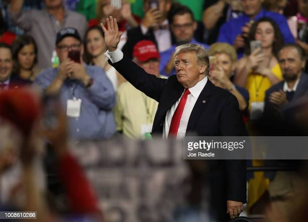 President Donald Trump waves as he exits after attending his Make America Great Again Rally at the Florida State Fair Grounds Expo Hall on July 31...