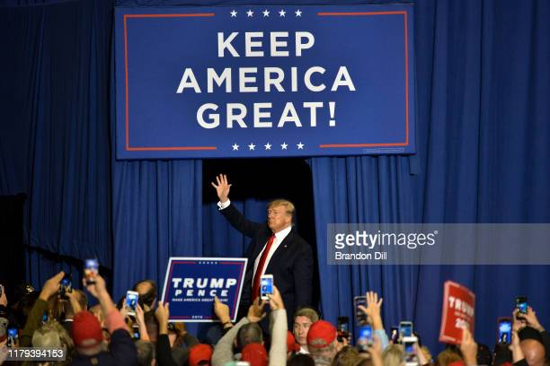 """President Donald Trump waves as he exits the stage during a """"Keep America Great"""" campaign rally at BancorpSouth Arena on November 1, 2019 in Tupelo,..."""