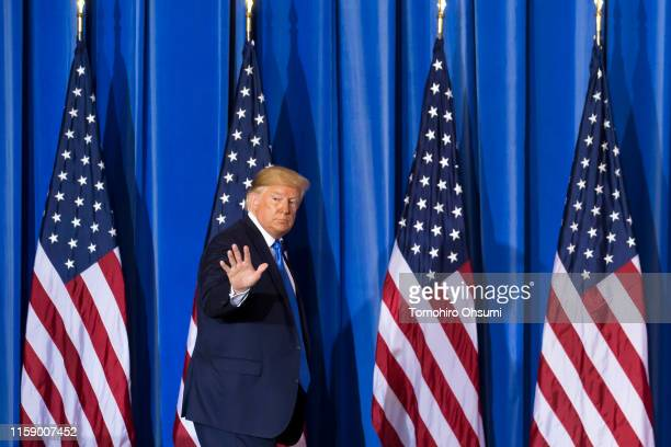 President Donald Trump waves as he leaves a press conference after the G-20 Summit on June 29, 2019 in Osaka, Japan. Trump and Chinese President Xi...