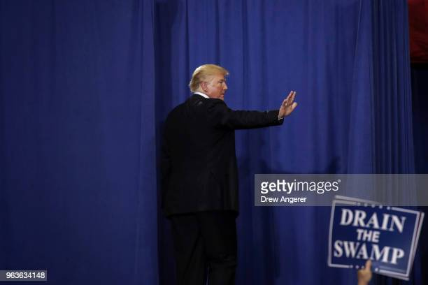 S President Donald Trump waves as he leaves a rally at the Nashville Municipal Auditorium May 29 2018 in Nashville Tennessee Earlier in the day...